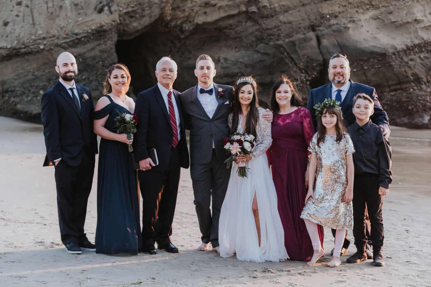 Seaside family portrait at an outdoor wedding by the cliffs