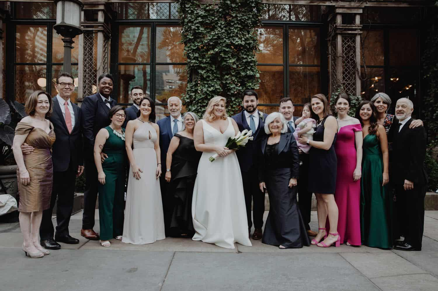 Large family portrait at a wedding in a courtyard