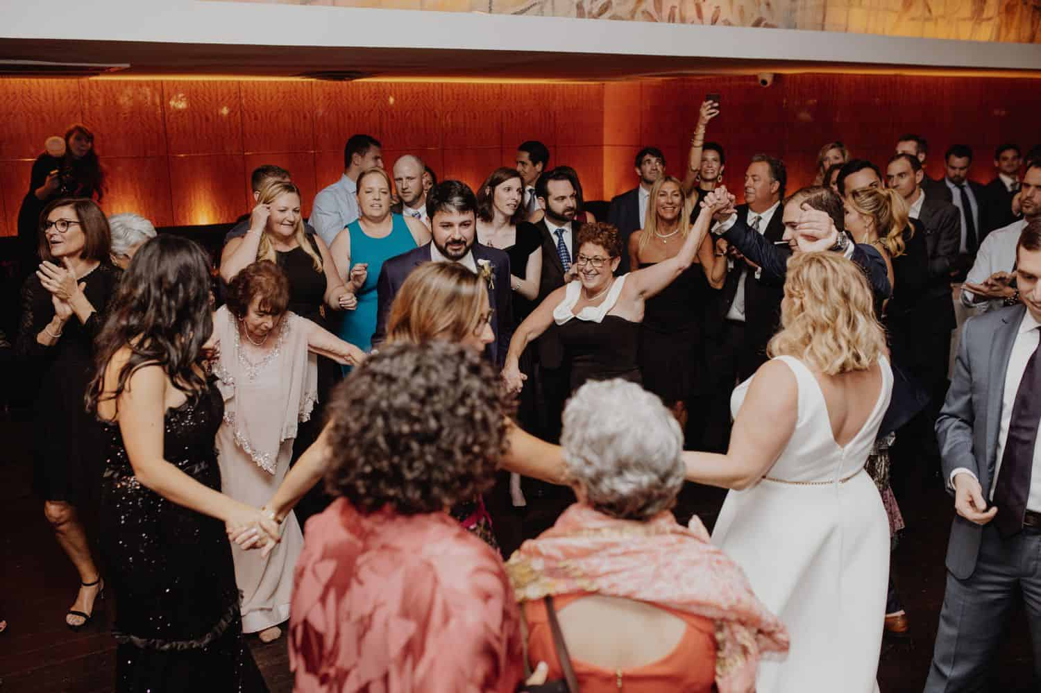 Family and friends dance the horah at a wedding