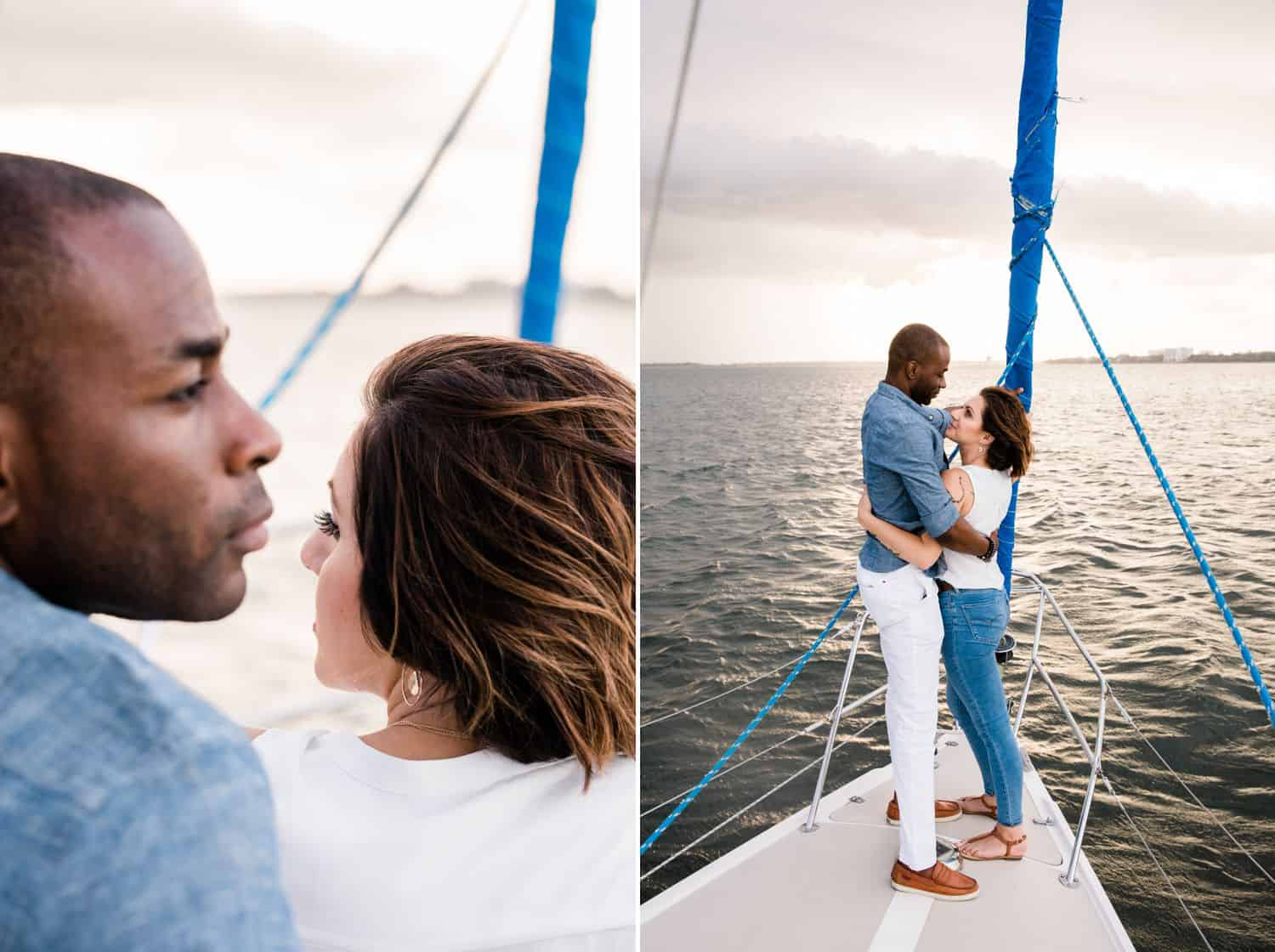 A Black man and a White woman sail together at sunset