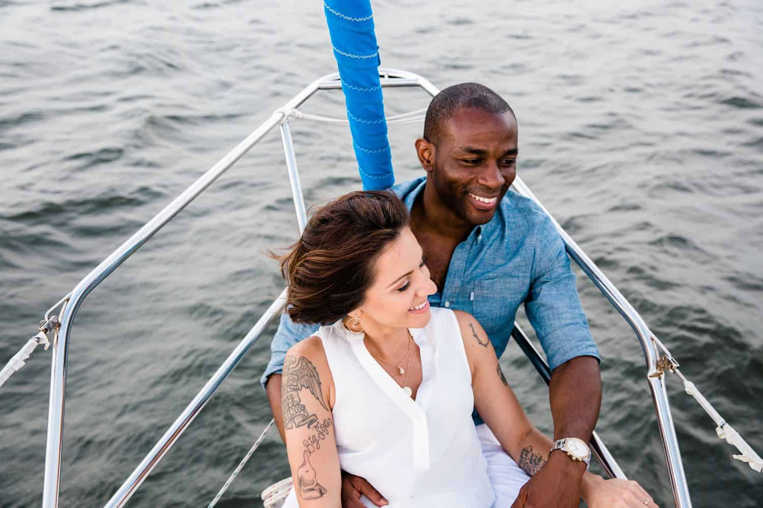 A Black man sails on a sailboat with his wife