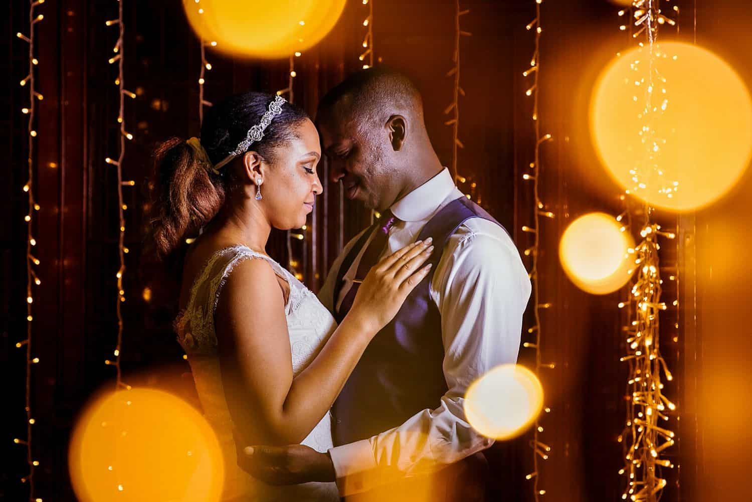 A bride and groom slow dance to their first song as husband and wife