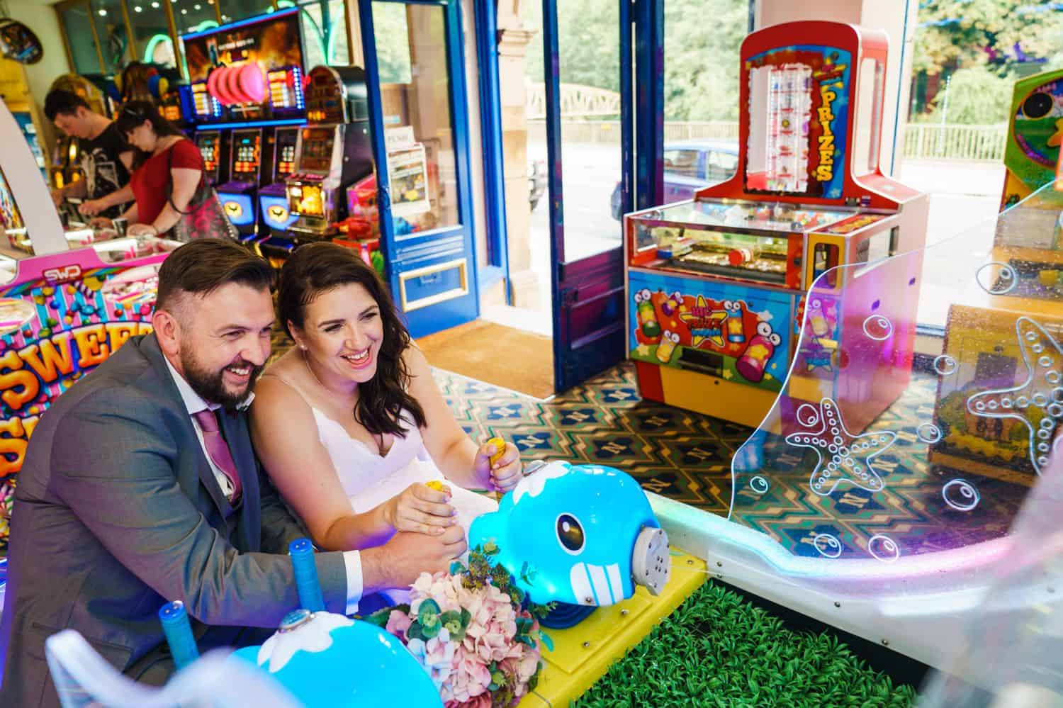 A bride and groom play carnival games on their wedding day
