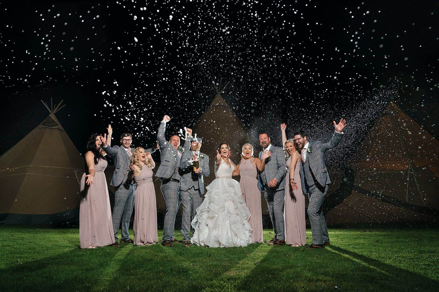 A wedding party cheers in this nighttime shot taken in the rain