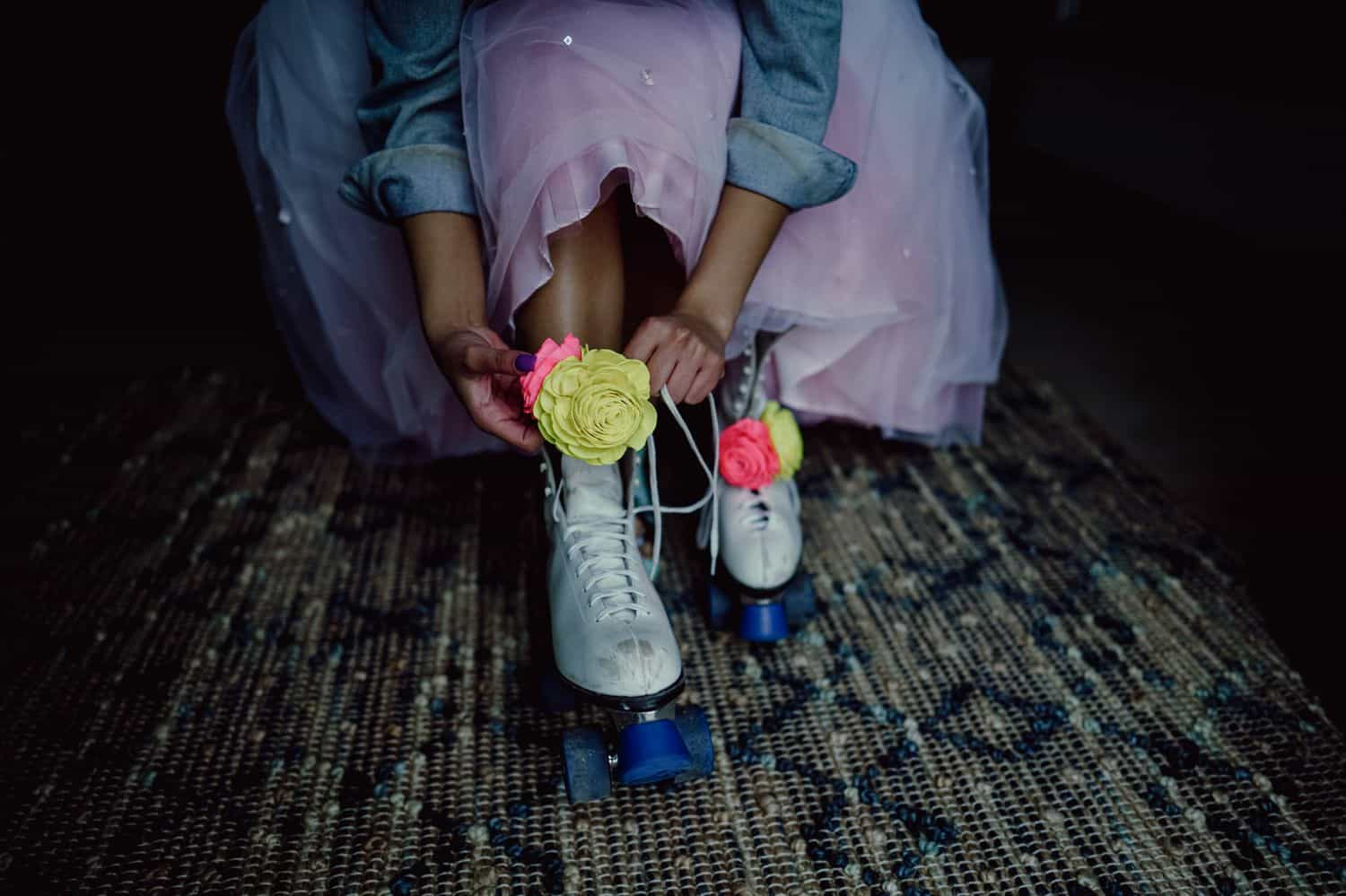 A bride laces up her roller skates for a fun-filled wedding reception