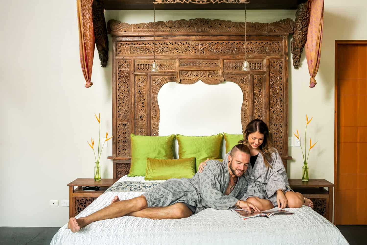 A couple reading a magazine together in bed