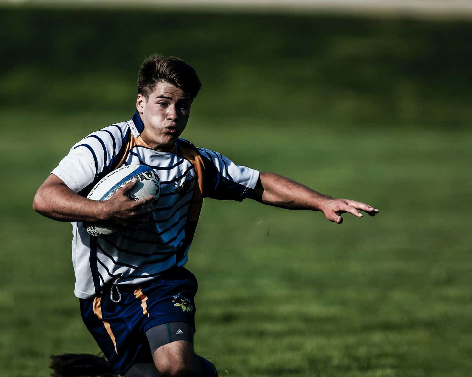 A rugby player running with ball
