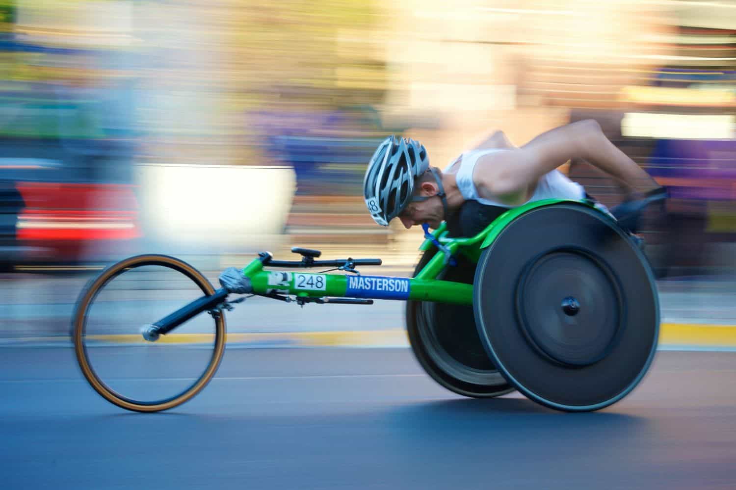 A paraplegic man joining wheelchair racing
