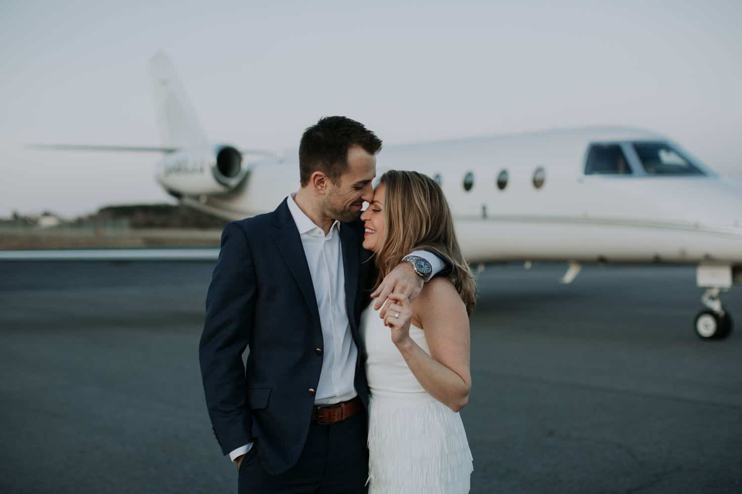 A photo of a couple taken at an airport