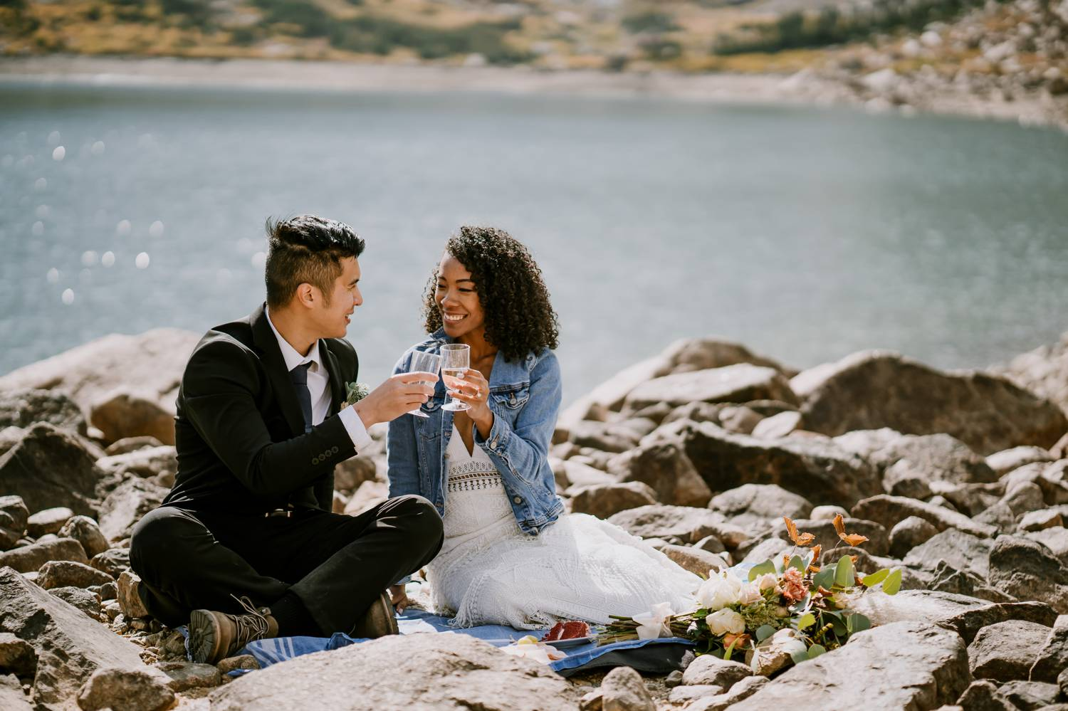 Customer Loyalty: By Nick Sparks, a bride and groom sip wine beside a sparkling lake.