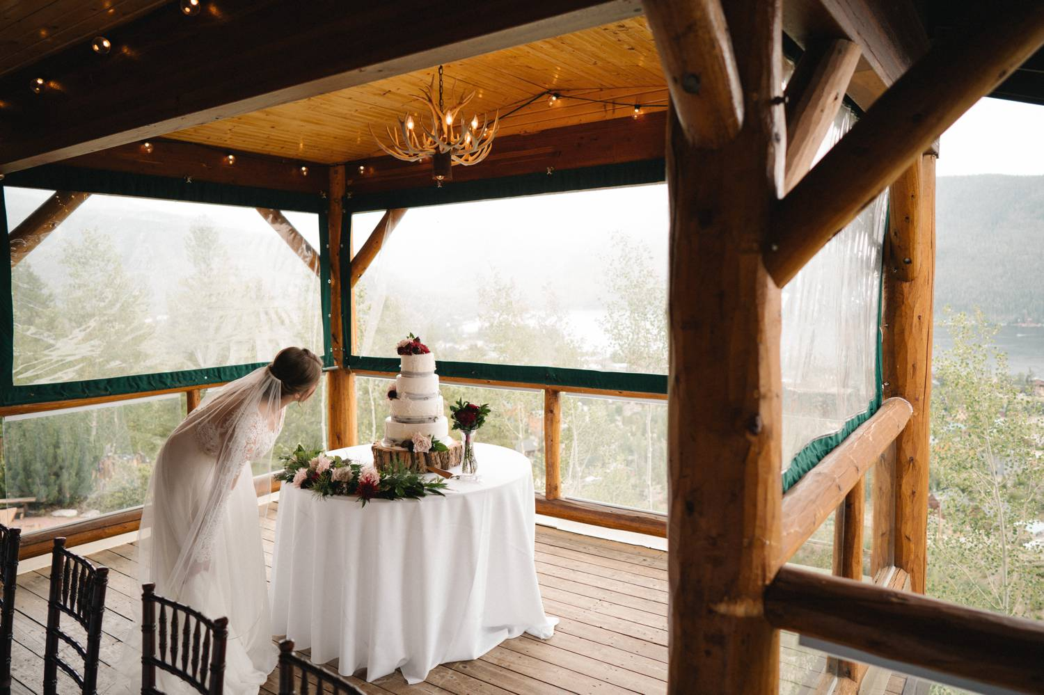 Customer Loyalty: By Nick Sparks, a bride bends forward to get a closer look at her wedding cake.