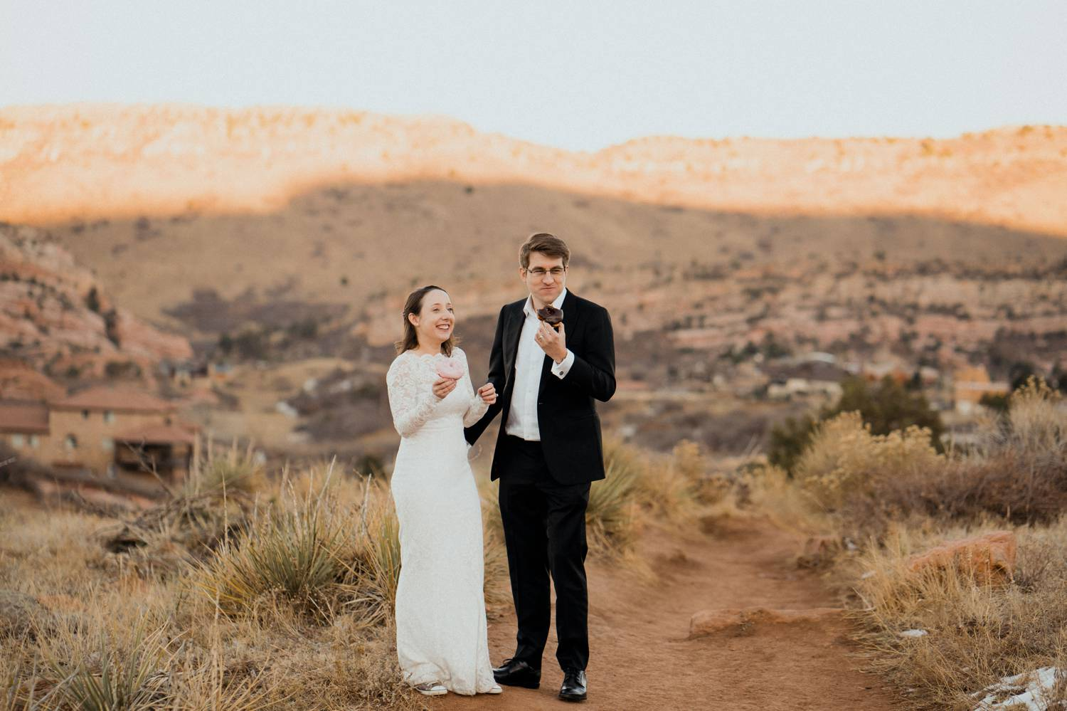 Customer Loyalty: By Nick Sparks, a bride and groom eat doughnuts in the mountains of Colorado.