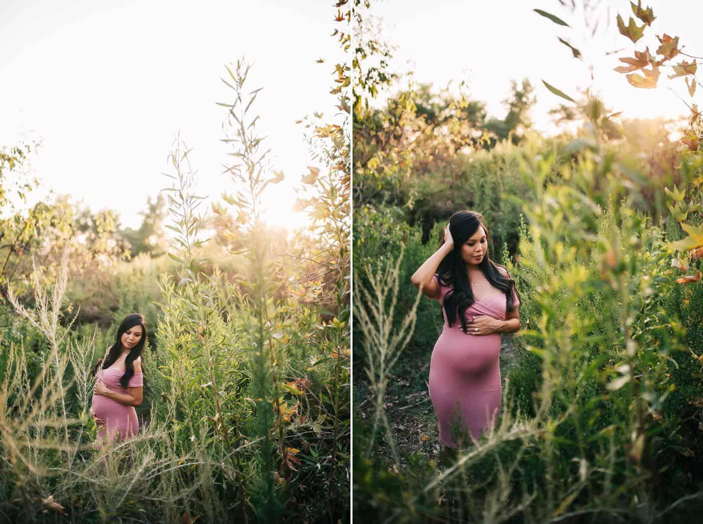 Janae Marie photographs a young pregnant mother in an overgrown field in a pink dress.