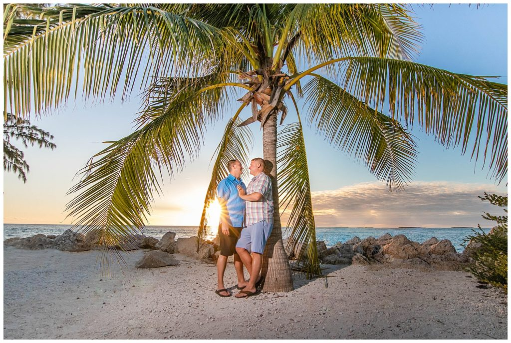 couple in front of palm tree