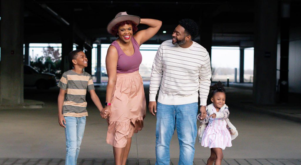 Houston photographer LaJune King poses while walking with her husband and their two children