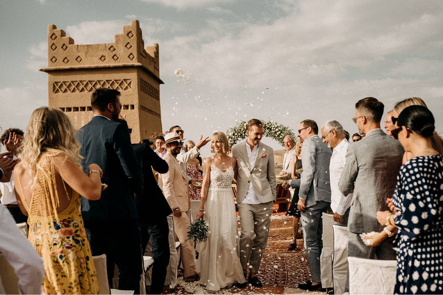 Aneta Lehotska's wedding photo depicts two newlyweds processing up the aisle as their guests shower them with flower petals.