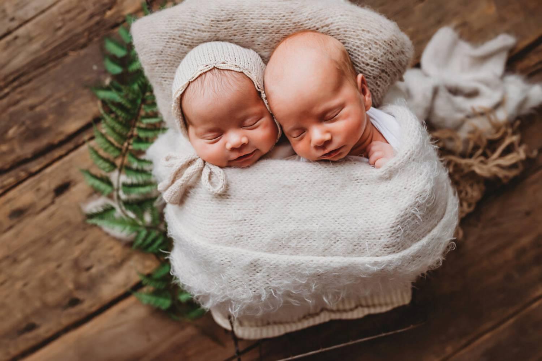 Photo: Brandi RIchardson's portrait of infant twins shows them bundled in soft cloth atop a barnwood backdrop.