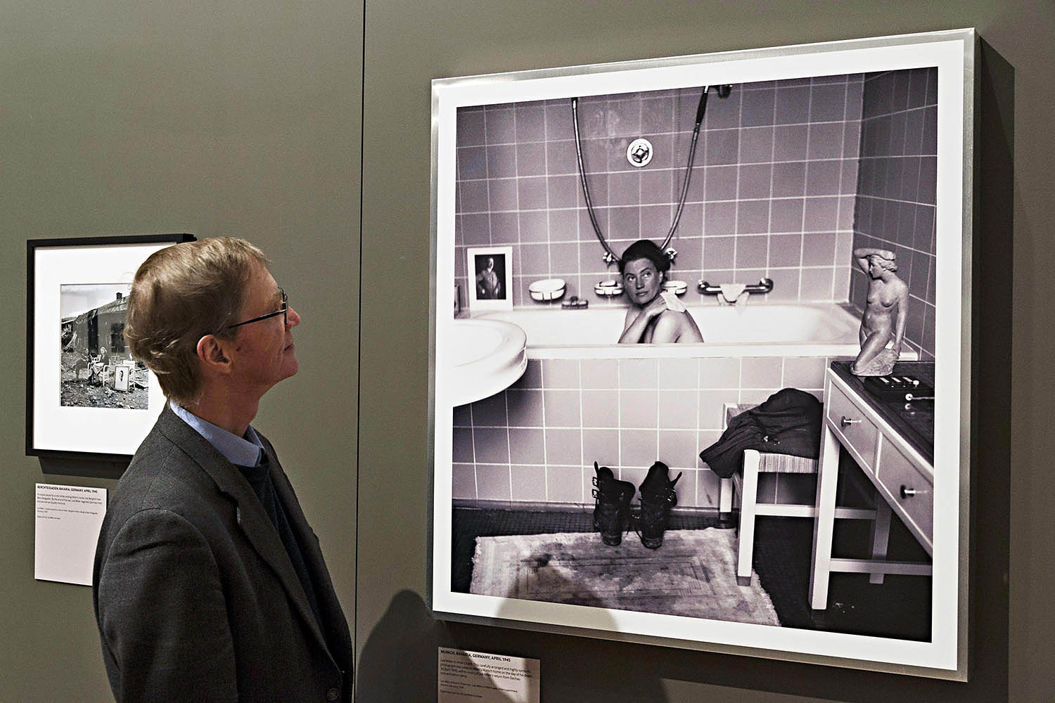A framed print of David E. Scherman's portrait of photojournalist Lee Miller in Adolf Hitler's bathtub after a disturbing visit to the Dachau concentration camp.