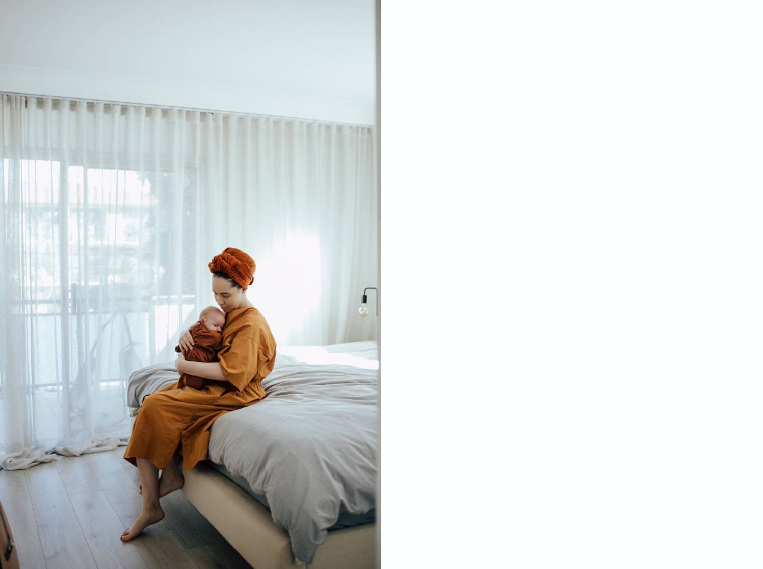 Photo: Martine Payne's simple portrait shows a mom in a yellow robe and orange head wrap snuggling her infant baby close as she sits on the edge of a white bed.