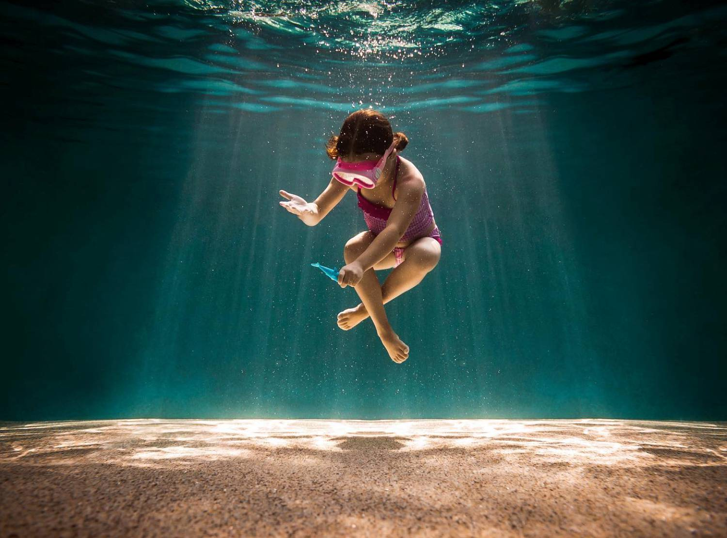 underwater photo of a child playing