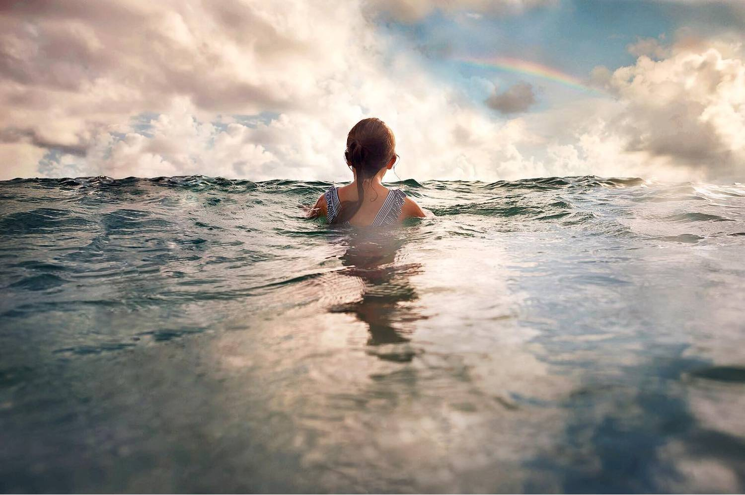 photo of a child swimming
