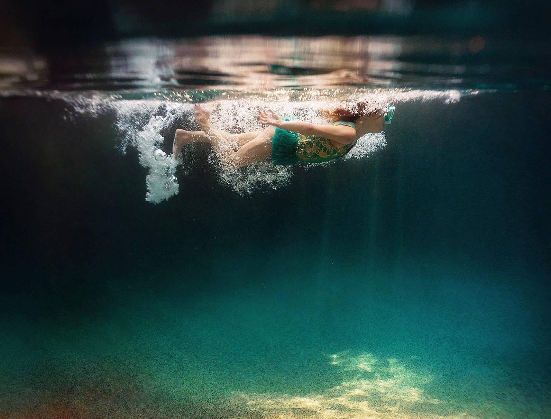 underwater photo of a child swimming