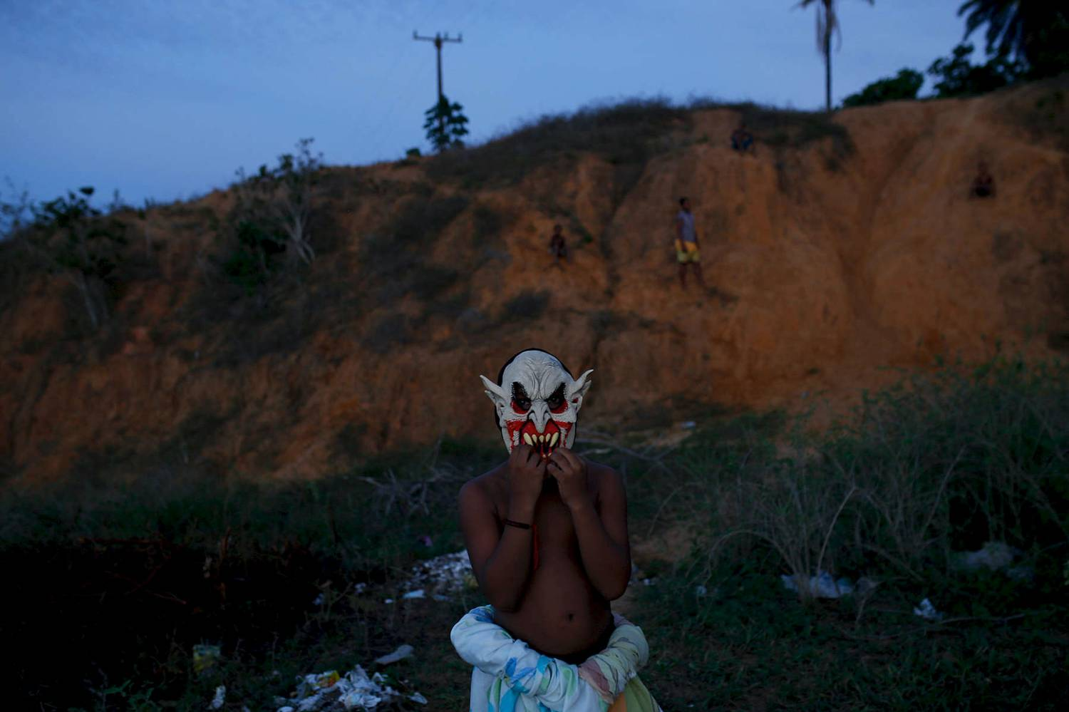 Photo: Stephanie Foden's dusk portrait of a young man wearing a devil mask.