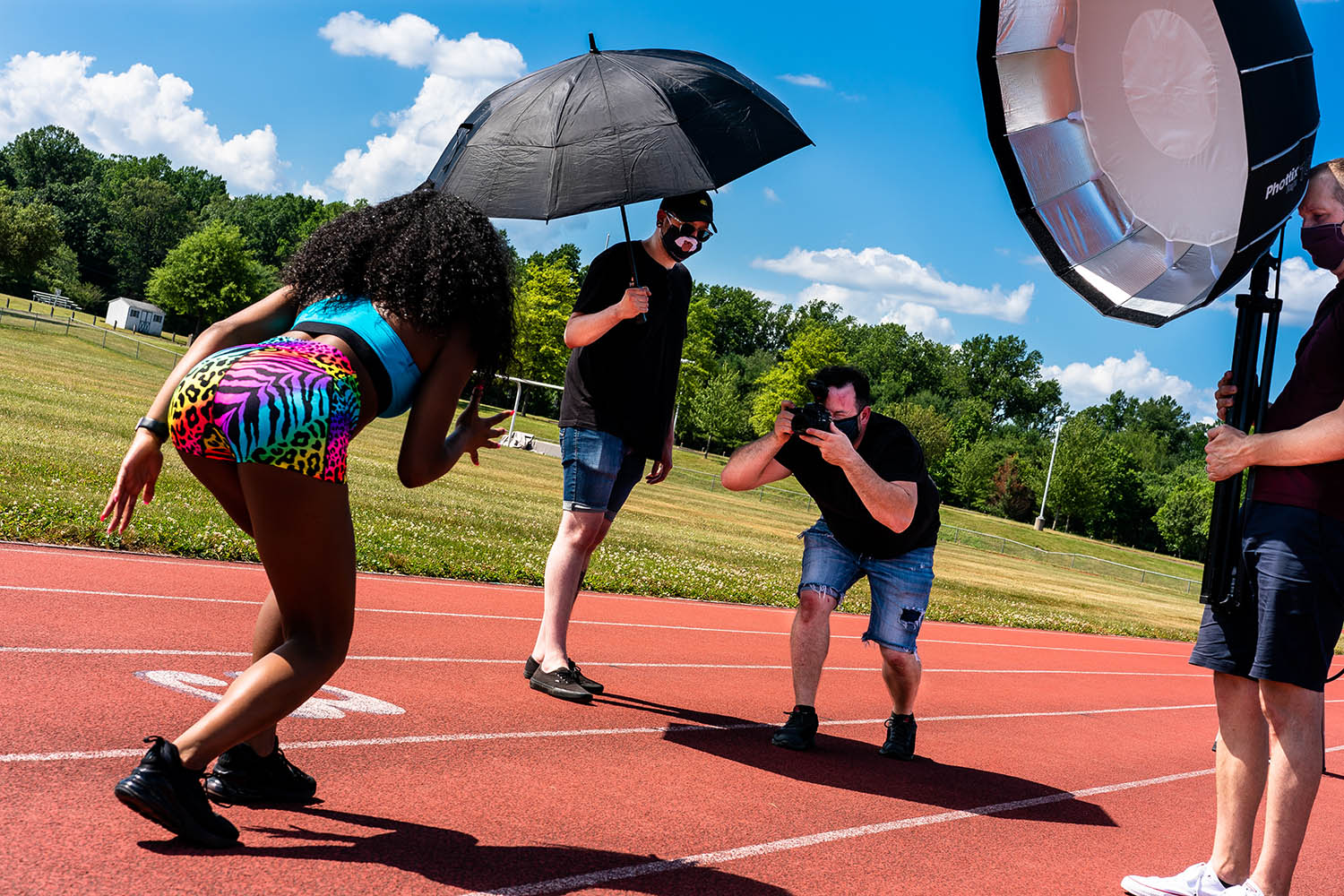 Photographer Joe Dantone works on a commercial set photographing athletes