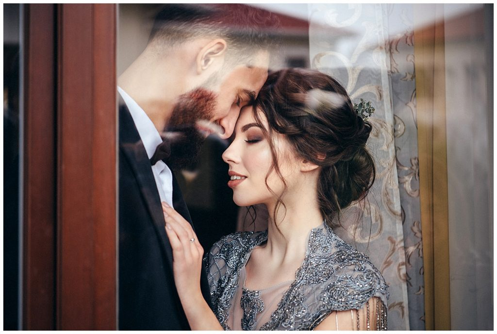 couple together in window