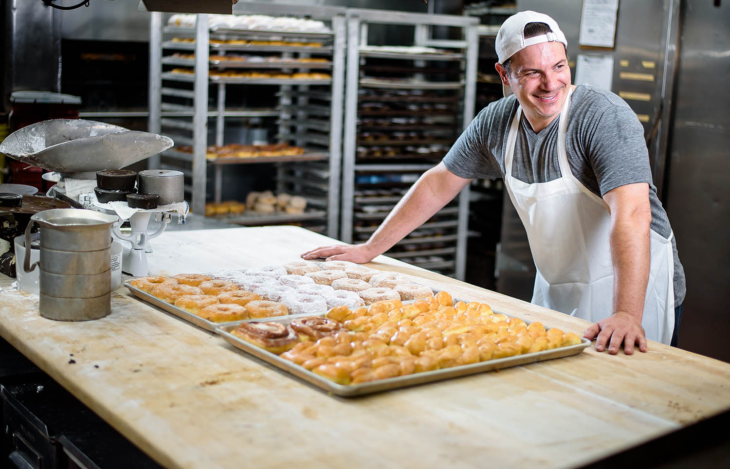 A pastry chef poses in his kitchen in this commercial image by Joe Dantone