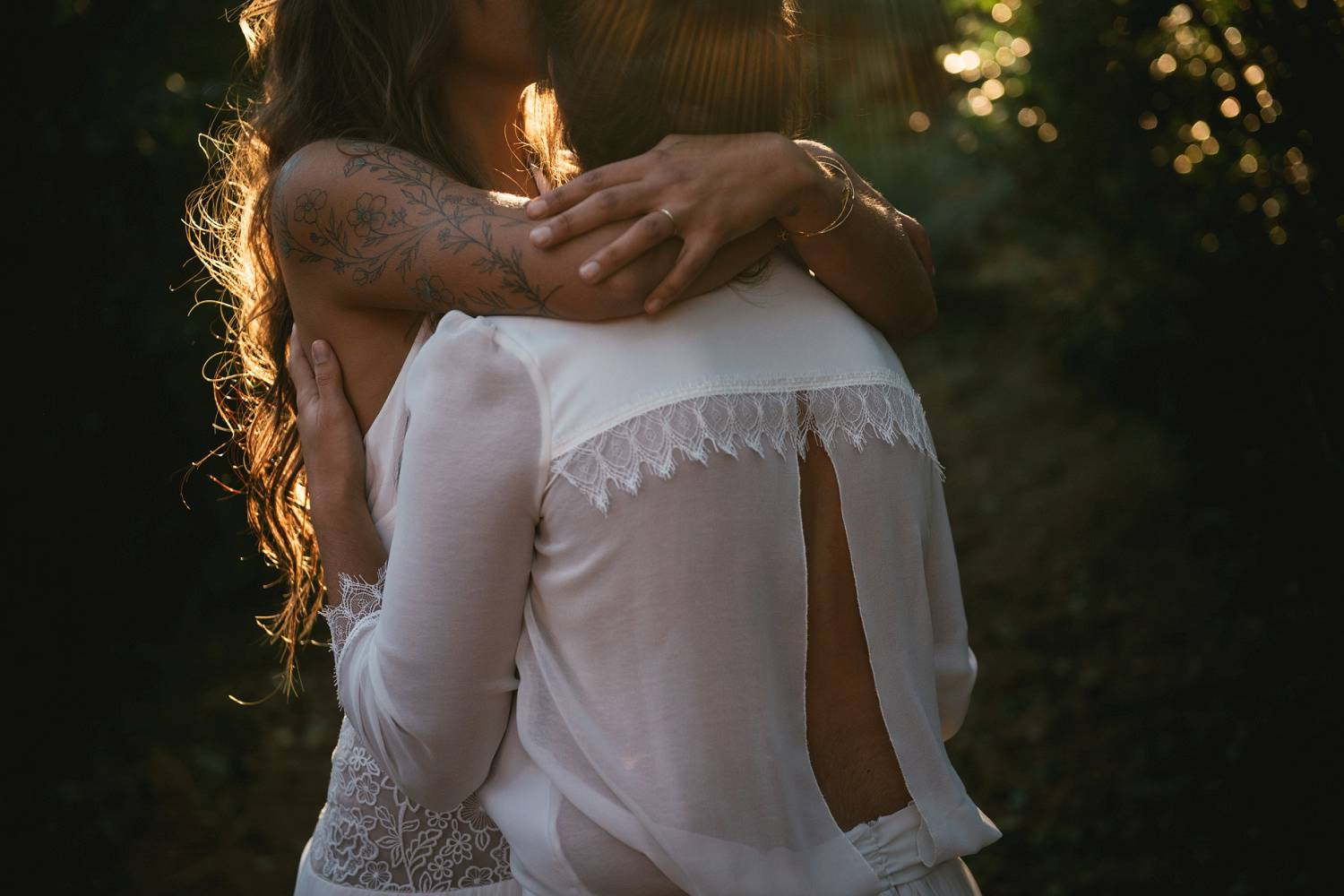 Two women hug each other close during their first look before they become wives