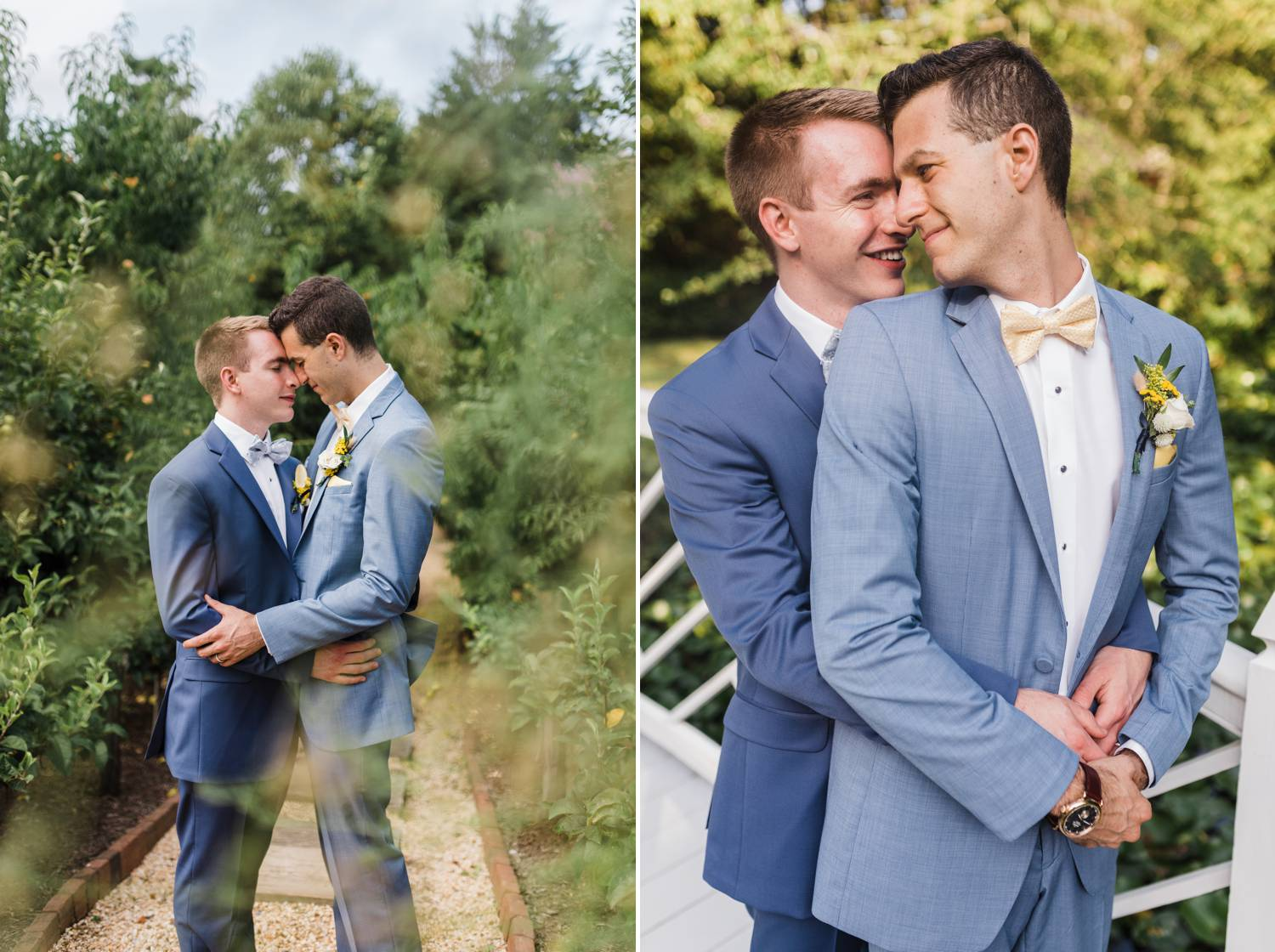 Two grooms wearing gray suits stand with their foreheads together