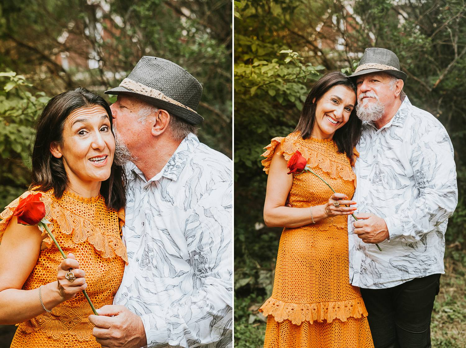A woman in a tangerine dress snuggles close with a bearded man wearing a gray hat