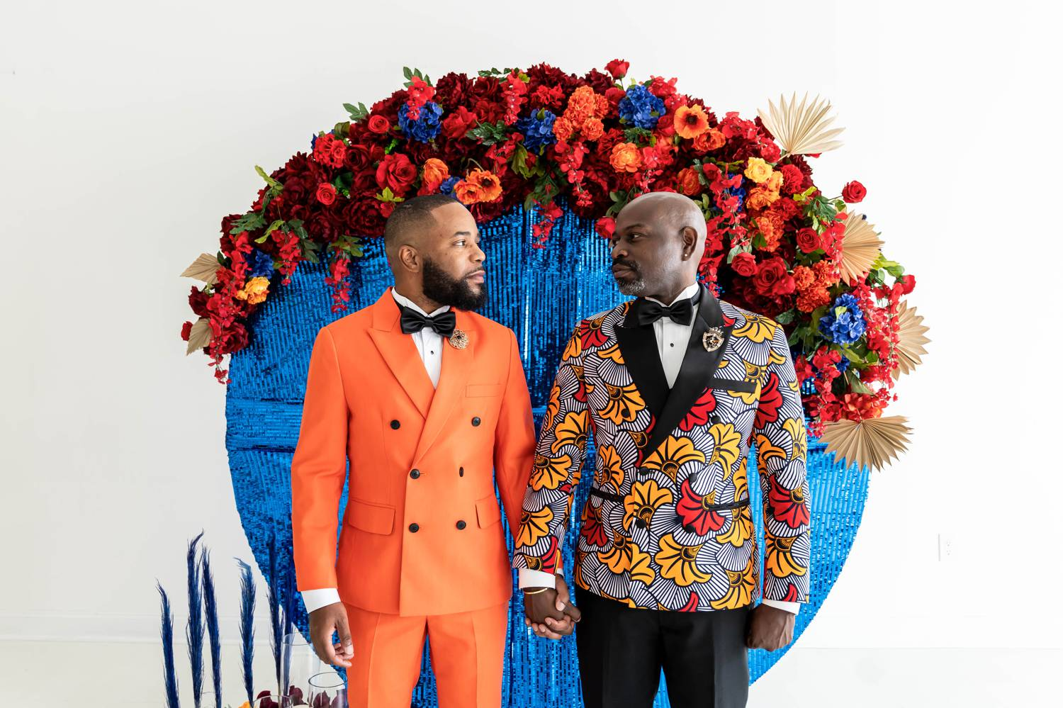 Atlanta grooms stand side-by-side in LaJoy Photography's daylight studio and pose for wedding portraits