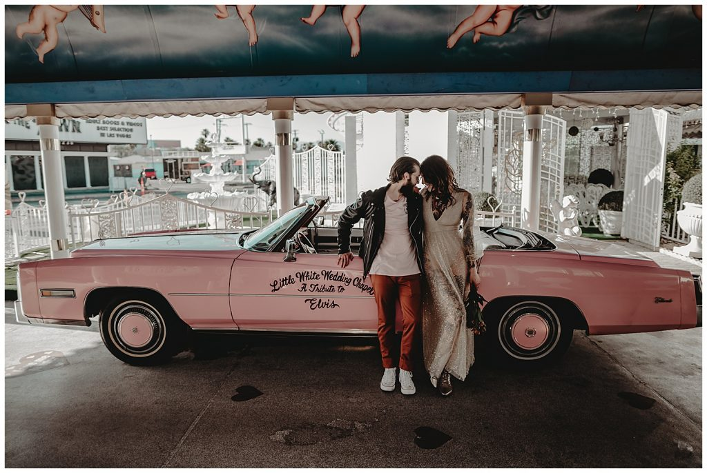couple in front of pink car