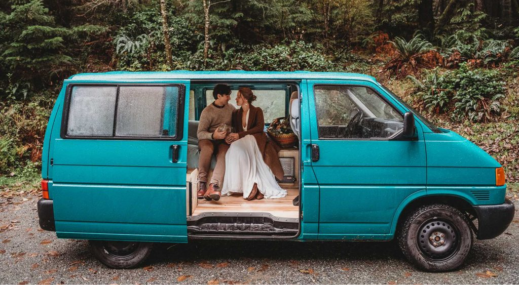 couple in teal van
