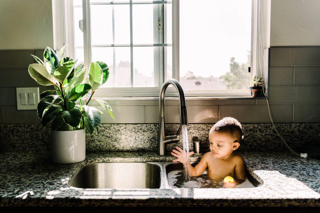 baby boy in sink