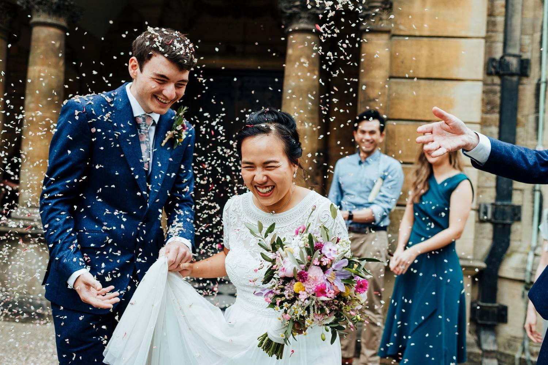 Bride and groom escape church under birdseed