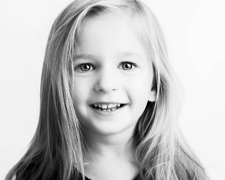 black and white studio portrait of a blonde girl