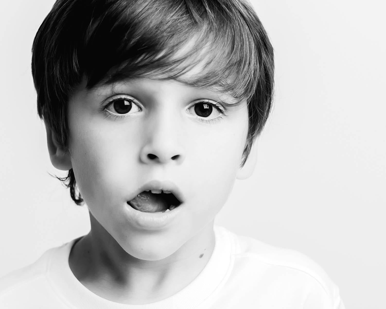 black and white studio portrait of a brunette boy