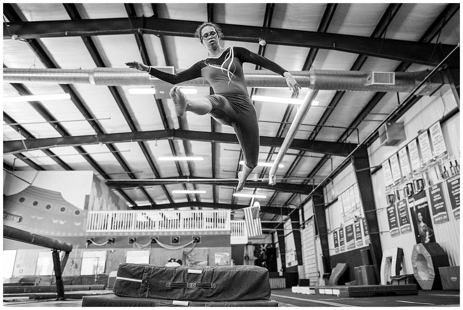 special olympics gymnast leaps through the air
