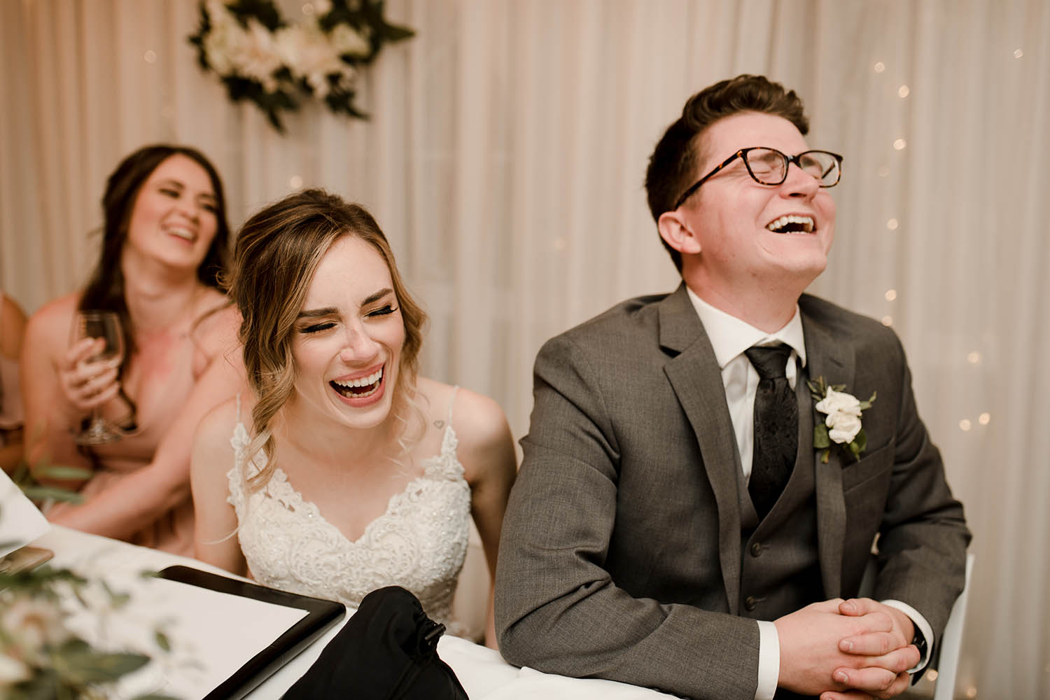 bride and groom laugh during reception