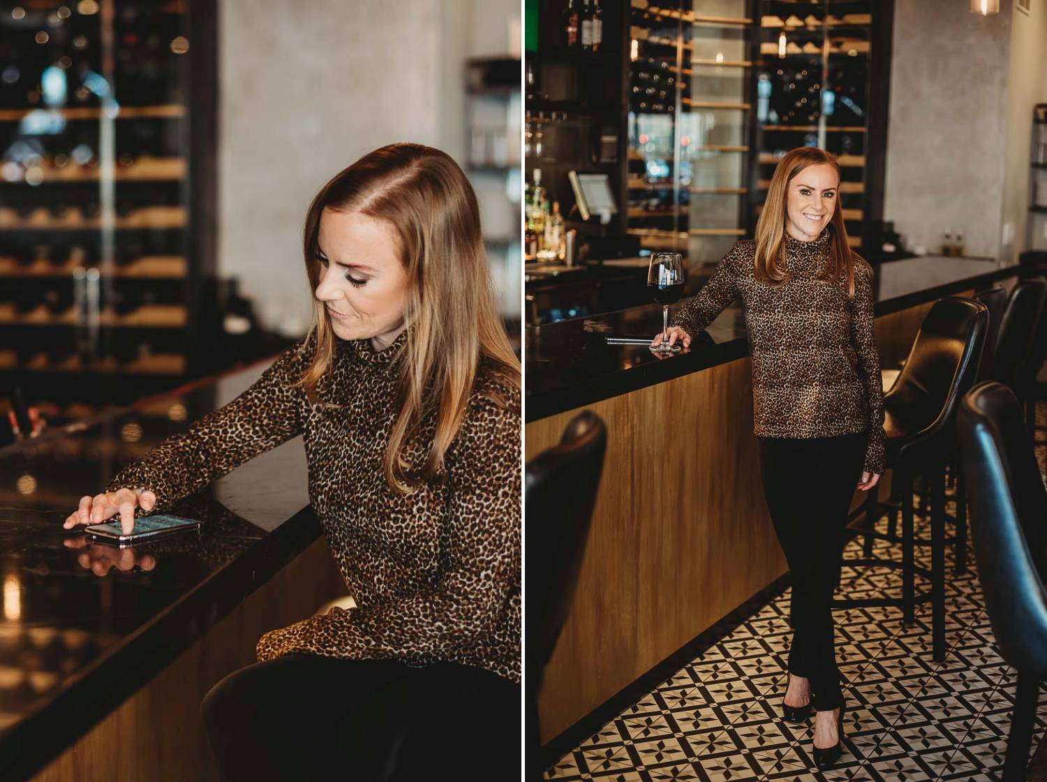 A woman sits at a wine bar in her work attire as she answers emails on her smartphone