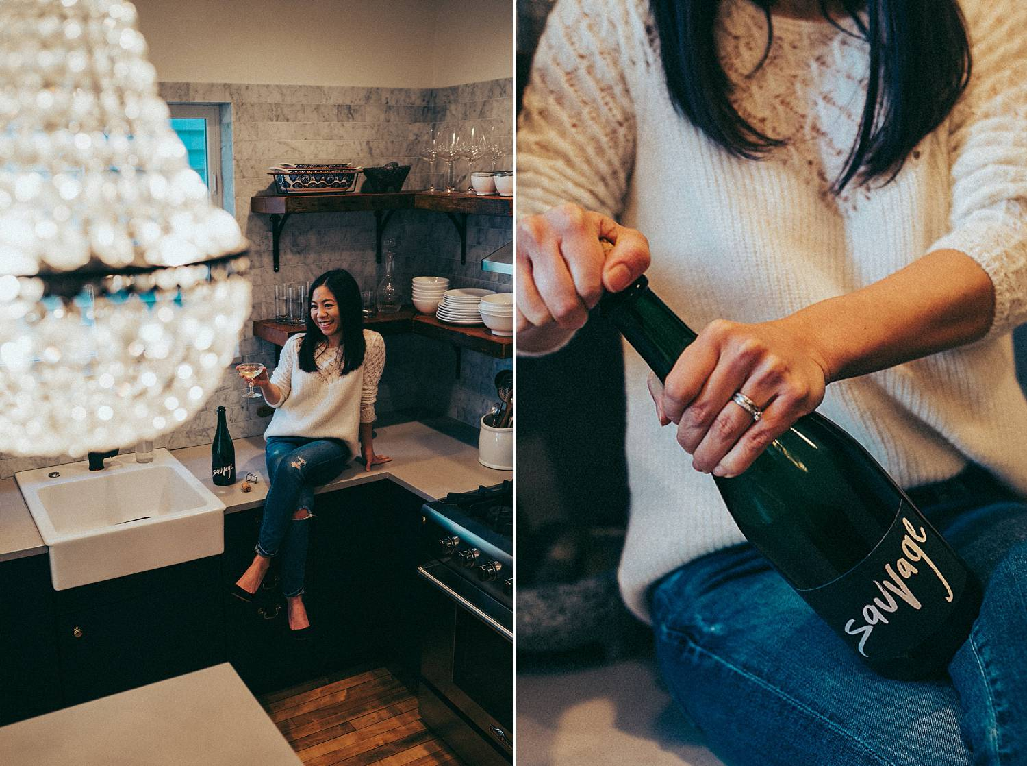 A female entrepreneur opens a bottle of champagne in her kitchen beneath a crystal chandelier. You'll have cause to celebrate, too, if you qualify for COVID relief for photographers.