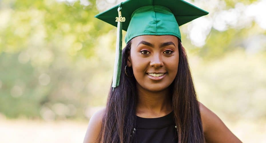 A high school senior poses in her graduation cap for the class of 2020