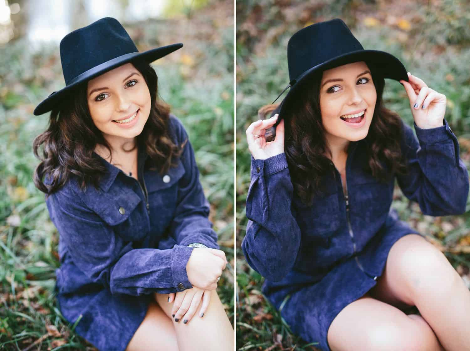A high school senior girl poses in a denim dress and a black boho hat