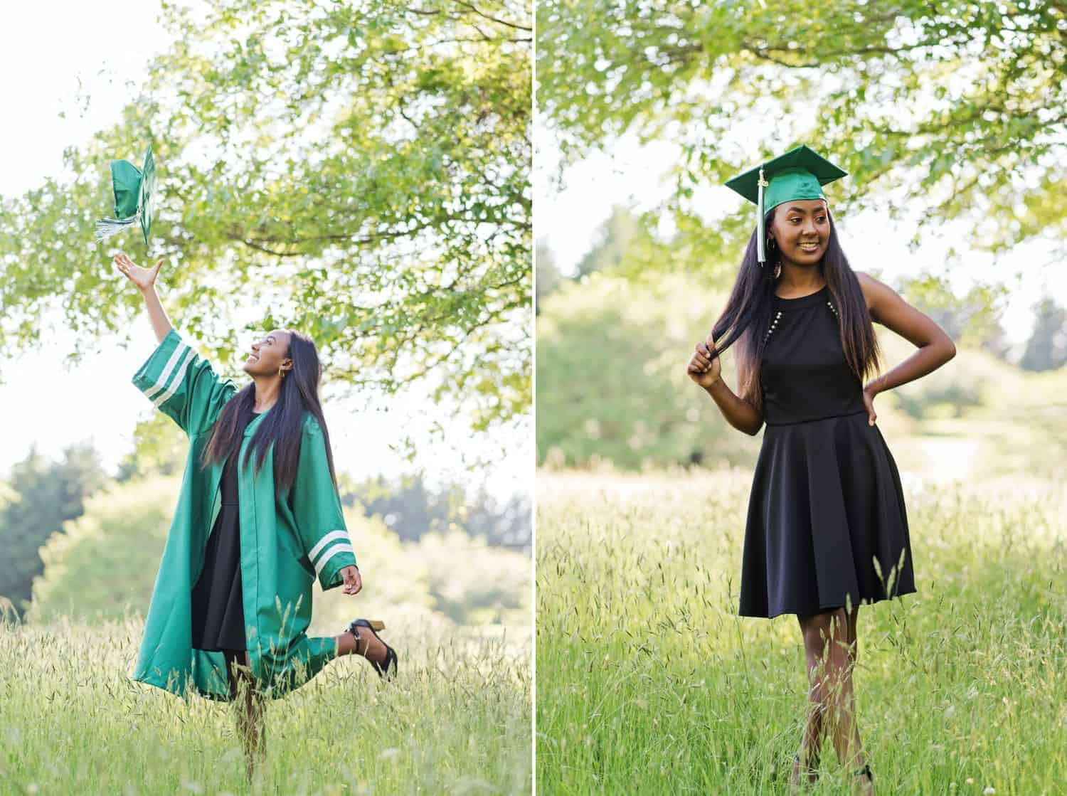 A high school senior girl poses wearing a black dress under her green graduation gown. She stands in a field and throws her cap into the air.