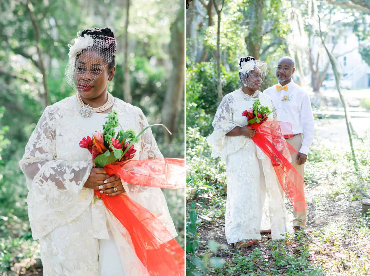 A beautiful Black bride carries a bouquet of red roses for portraits with her new husband