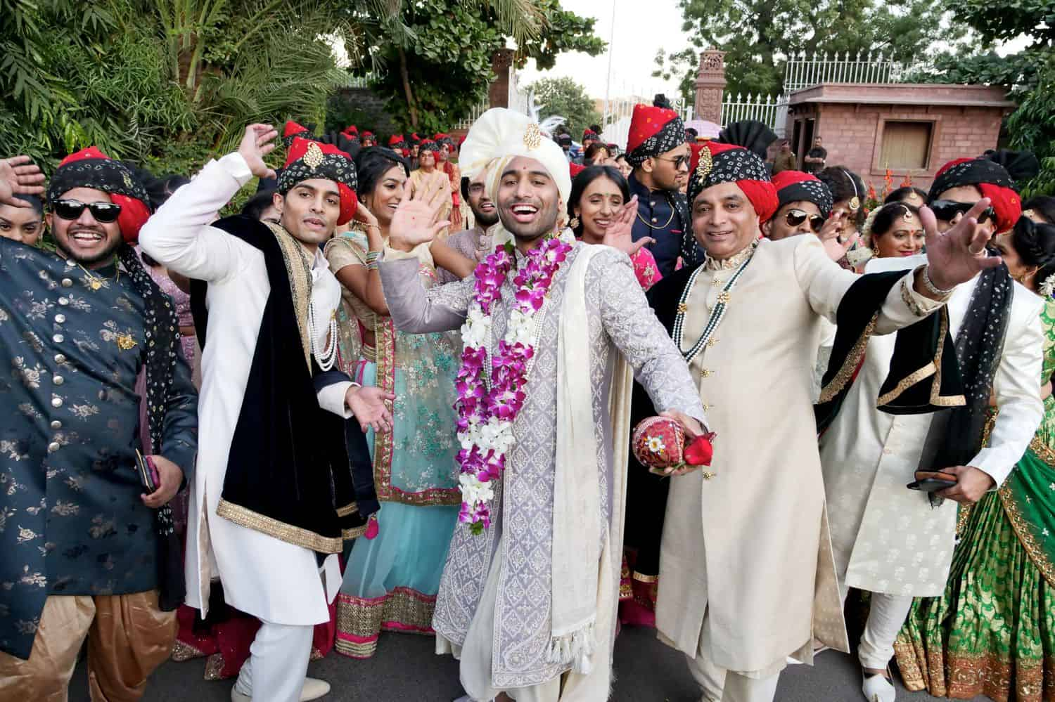 An Indian groom together with wedding guests
