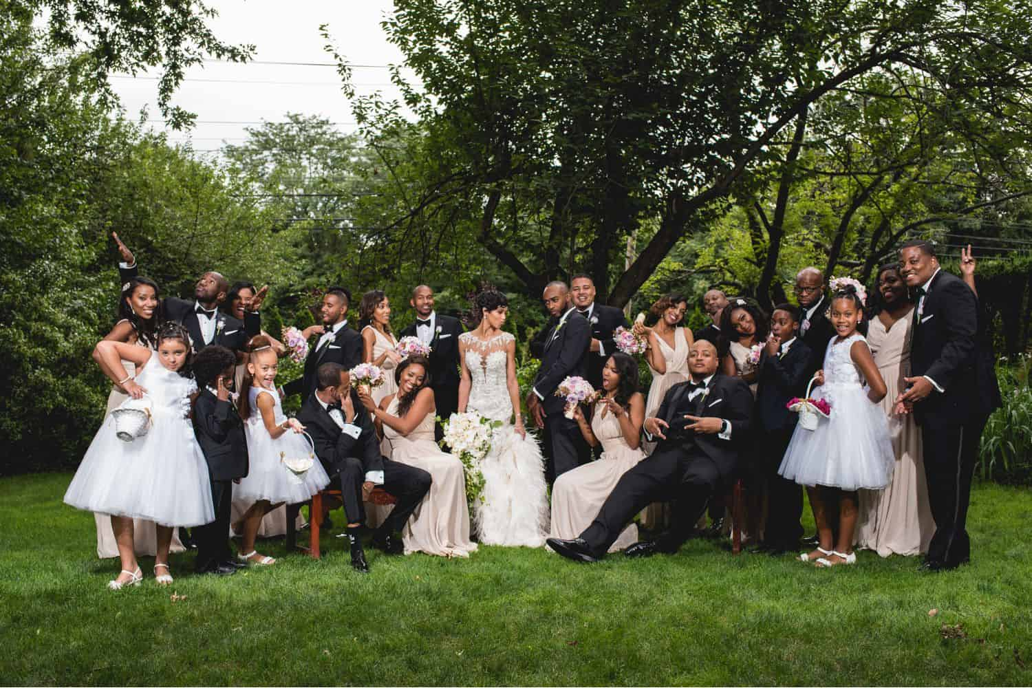 A fun outdoor family wedding photo with a large group